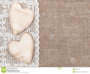 burlap background with white lacy cloth and wooden hearts dxxh2a clipart